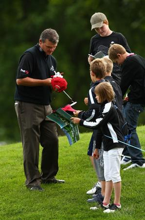 LUSS, SCOTLAND - JULY 08:  Paul Lawrie of Scotland signs autographs during the Pro Am prior to The Barclays Scottish Open at Loch Lomond Golf Club on July 08, 2009 in Luss, Scotland.  (Photo by Richard Heathcote/Getty Images)