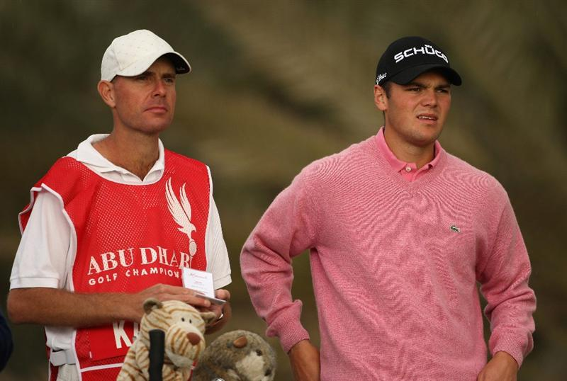 ABU DHABI, UNITED ARAB EMIRATES - JANUARY 15:  Martin Kaymer of Germany waits with his caddie on the 14th hole during the first round of The Abu Dhabi Golf Championship at Abu Dhabi Golf Club on January 15, 2009 in Abu Dhabi, United Arab Emirates.  (Photo by Andrew Redington/Getty Images)