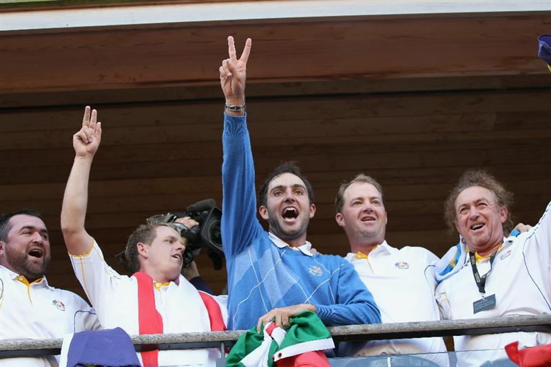 NEWPORT, WALES - OCTOBER 04: (L-R) Luke Donald, Edoardo Molinari, Peter Hanson and Miguel Angel Jimenez celebrate on the blacony of the clubhouse following Europe's victory in the 2010 Ryder Cup at the Celtic Manor Resort on October 4, 2010 in Newport, Wales. (Photo by Ross Kinnaird/Getty Images)