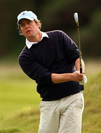 KINGSBARNS, UNITED KINGDOM - OCTOBER 01:  Hollywood actor, Hugh Grant, plays his second shot on the first hole during the final practice round of The Alfred Dunhill Links Championship at Kingsbarns Golf Links on October 1, 2008 in Kingbarns, Scotland.  (Photo by Andrew Redington/Getty Images)
