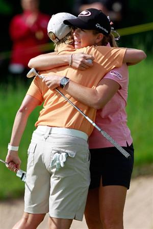 GLADSTONE, NJ - MAY 20:  (R - L) Paula Creamer hugs Karrie Webb of Australia following her birdie on the eighteenth green to give her victory in round two of the Sybase Match Play Championship at Hamilton Farm Golf Club on May 20, 2011 in Gladstone, New Jersey.  (Photo by Chris Trotman/Getty Images)