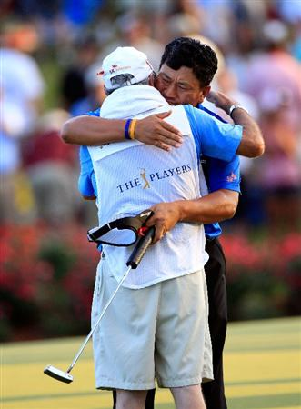 PONTE VEDRA BEACH, FL - MAY 15:  K.J. Choi of South Korea celebrates with caddie Andy Prodger after making a par-saving putt to defeat David Toms on the first playoff hole to win THE PLAYERS Championship held at THE PLAYERS Stadium course at TPC Sawgrass on May 15, 2011 in Ponte Vedra Beach, Florida.  (Photo by Sam Greenwood/Getty Images)