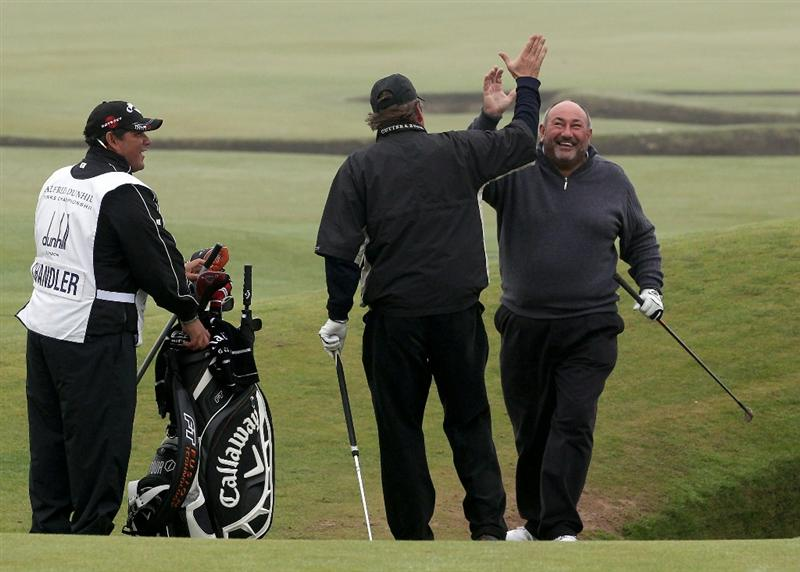 ST ANDREWS, SCOTLAND - OCTOBER 08:  Chubby Chandler is congratulated by Johann Rupert after chipping out of the bunker on the 17th green during the second round of The Alfred Dunhill Links Championship at The Old Course on October 8, 2010 in St Andrews, Scotland.  (Photo by Ross Kinnaird/Getty Images)