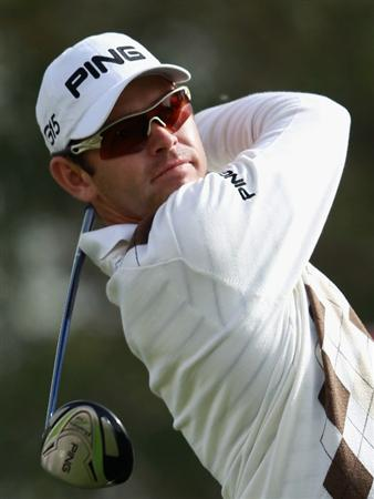DOHA, QATAR - FEBRUARY 03:  Louis Oosthuizen of South Africa hits his tee-shot on the 18th hole during the first round of the Commercialbank Qatar Masters held at Doha Golf Club on February 3, 2011 in Doha, Qatar.  (Photo by Andrew Redington/Getty Images)
