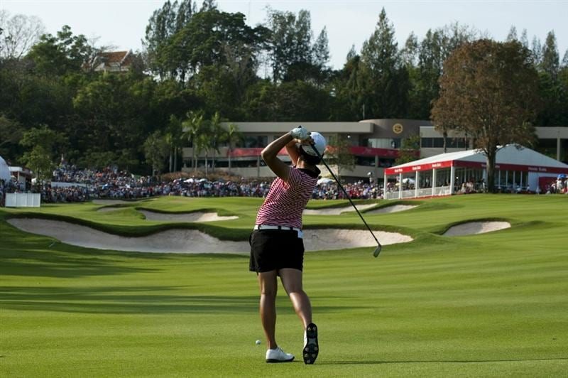 CHON BURI, THAILAND - FEBRUARY 20:  Yani Tseng of Taiwan plays her second shot on the 18th hole during day four of the LPGA Thailand at Siam Country Club on February 20, 2011 in Chon Buri, Thailand.  (Photo by Victor Fraile/Getty Images)