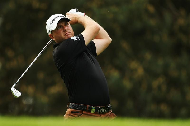 VIRGINIA WATER, ENGLAND - MAY 20:  Graeme Storm of England plays an iron shot during the first round of the BMW PGA Championship on the West Course at Wentworth on May 20, 2010 in Virginia Water, England.  (Photo by Ian Walton/Getty Images)