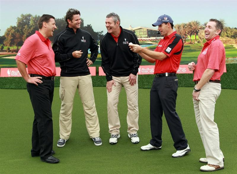 ABU DHABI, UNITED ARAB EMIRATES - JANUARY 22:  Padraig Harrington of Ireland (2nd R) offers advice to (L-R) Simon Cooper, the CEO of HSBC Middle East and North Africa, HSBC sporting ambassadors Chris Cairns, Gavin Hastings and Jonathan Davies at a golf skills clinic during the third round of The Abu Dhabi HSBC Golf Championship at Abu Dhabi Golf Club on January 22, 2011 in Abu Dhabi, United Arab Emirates.  (Photo by Andrew Redington/Getty Images)