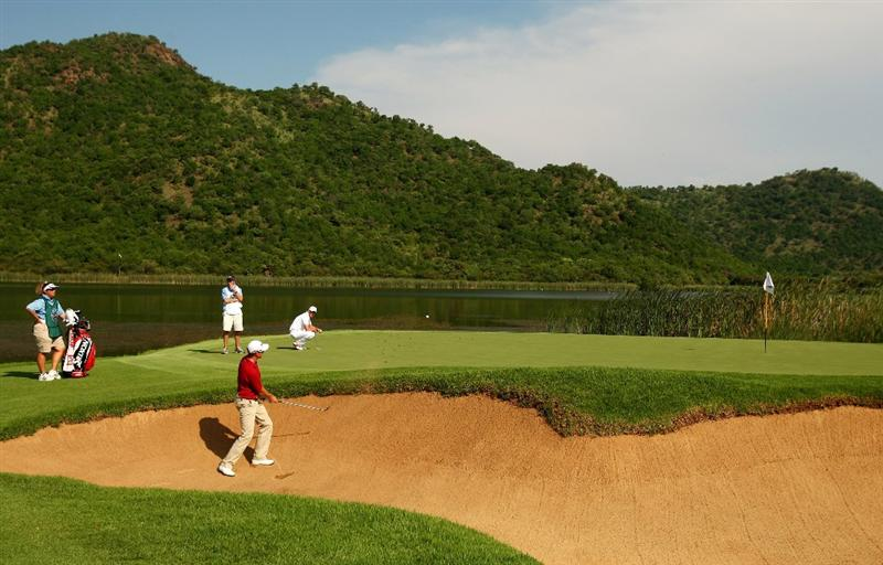 SUN CITY, SOUTH AFRICA - DECEMBER 07:  Henrik Stenson of Sweden plays from a greenside bunker on the 17th during the final round of the Nedbank Golf Challenge at the Gary Player Country Club on December 7, 2008 in Sun City, South Africa.  (Photo by Richard Heathcote/Getty Images)