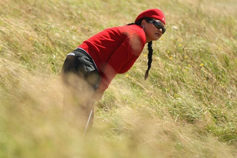LYTHAM ST ANNES, ENGLAND - AUGUST 02:  Christina Kim of USA watches her second shot on the 4th hole during the final round of the 2009 Ricoh Women's British Open Championship held at Royal Lytham St Annes Golf Club, on August 2, 2009 in Lytham St Annes, England.  (Photo by Warren Little/Getty Images)