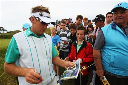 SOUTHPORT, UNITED KINGDOM - JULY 15:  Ian Poulter of England signs autographs for fans during the second practice round of the 137th Open Championship on July 15, 2008 at Royal Birkdale Golf Club, Southport, England. (Photo by Stuart Franklin/Getty Images)