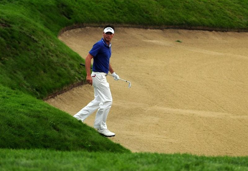 VIENNA, AUSTRIA - SEPTEMBER 17:  Nick Dougherty of England walks into a fairway bunker on the 14th during the first round of the Austrian Golf Open at Fontana Golf Club on September 17, 2009 in Vienna, Austria.  (Photo by Richard Heathcote/Getty Images)