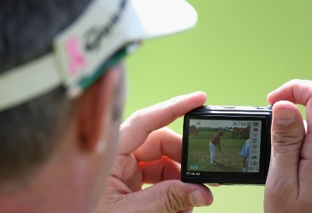 MARBELLA, SPAIN - MARCH 26: Phil Morbey the caddie of Darren Clarke take pictures of his player on the driving range during the pro-am event prior to the Open de Andalucia at the Aloha Golf Club on March 26, 2008 in Marbella, Spain.  (Photo by Ross Kinnaird/Getty Images)