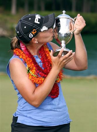 KAHUKU, HI - FEBRUARY 14:  Angela Stanford kisses the winner's trophy after winning the SBS Open on February 14, 2009 at the Turtle Bay Resort in Kahuku, Hawaii.  (Photo by Andy Lyons/Getty Images)