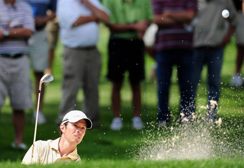 AKRON, OH - AUGUST 07:  Mike Weir of Canada plays his bunker shot on the 11th hole during the second round of the World Golf Championship Bridgestone Invitational on August 7, 2009 at Firestone Country Club in Akron, Ohio.  (Photo by Stuart Franklin/Getty Images)
