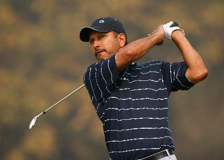 NEW DELHI, INDIA - FEBRUARY 06:  Jeev Milkha Singh of India plays an approach shot during the Pro - Am at the Emaar-MGF Indian Masters at the Delhi Golf Club on February 6, 2008 in Delhi, India.  (Photo by Stuart Franklin/Getty Images)
