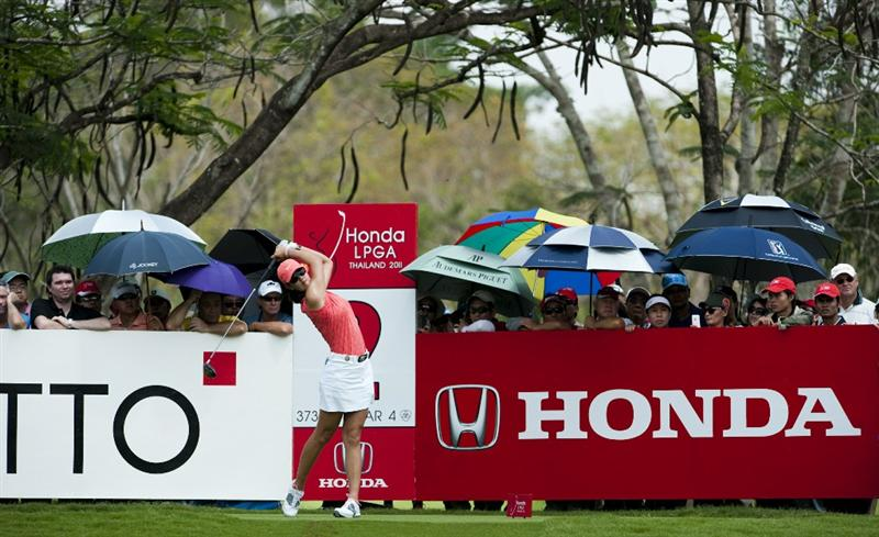 CHON BURI, THAILAND - FEBRUARY 20:  Michelle Wie of USA tees off on the 2nd hole during day four of the LPGA Thailand at Siam Country Club on February 20, 2011 in Chon Buri, Thailand.  (Photo by Victor Fraile/Getty Images)