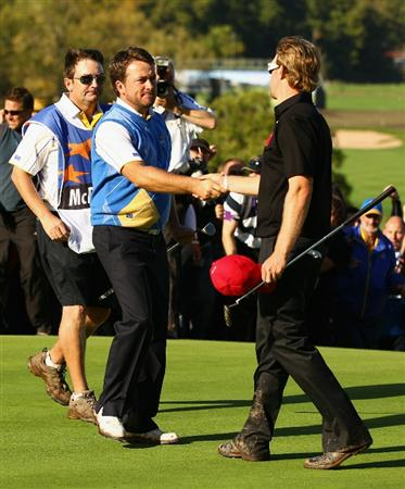 NEWPORT, WALES - OCTOBER 04:  Graeme McDowell of Europe shakes hands with Hunter Mahan (R) of the USA after securing victory for the European team on the 17th green in the singles matches during the 2010 Ryder Cup at the Celtic Manor Resort on October 4, 2010 in Newport, Wales.  (Photo by Richard Heathcote/Getty Images)