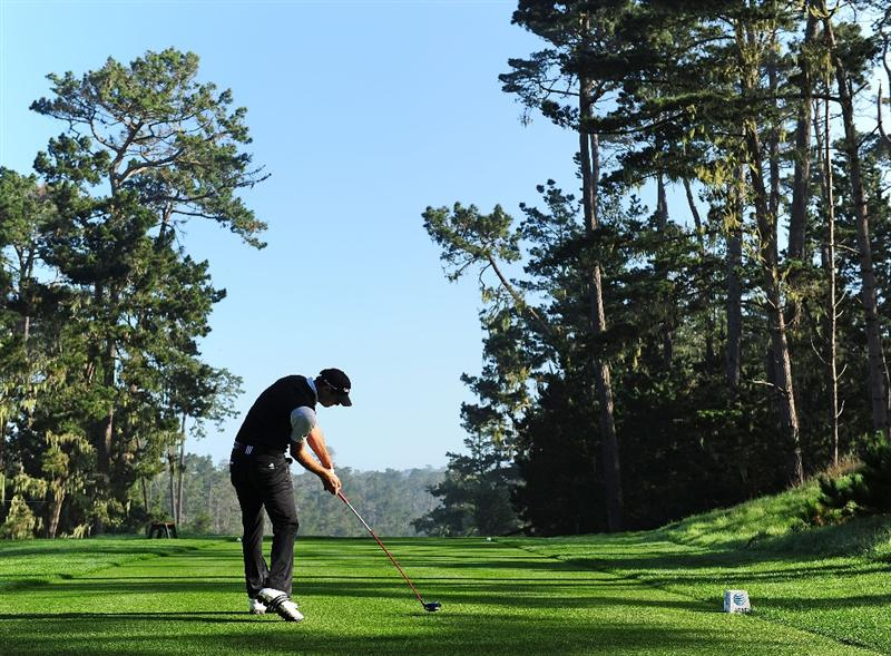 PEBBLE BEACH, CA - FEBRUARY 13:  Dustin Johnson plays his tee shot on the seventh hole during round three of the AT&T Pebble Beach National Pro-Am at Spyglass Hill Golf Course on February 13, 2010 in Pebble Beach, California.  (Photo by Stuart Franklin/Getty Images)