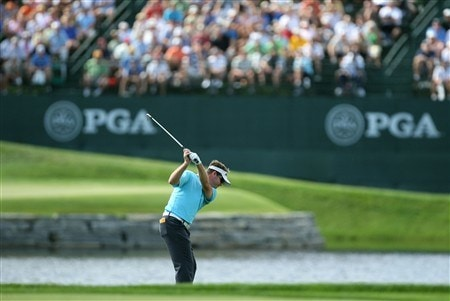 BLOOMFIELD HILLS, MI - AUGUST 07:  Brian Gay hits his second shot to the 16th green during round one of the 90th PGA Championship at Oakland Hills Country Club on August 7, 2008 in Bloomfield Township, Michigan.  (Photo by David Cannon/Getty Images)