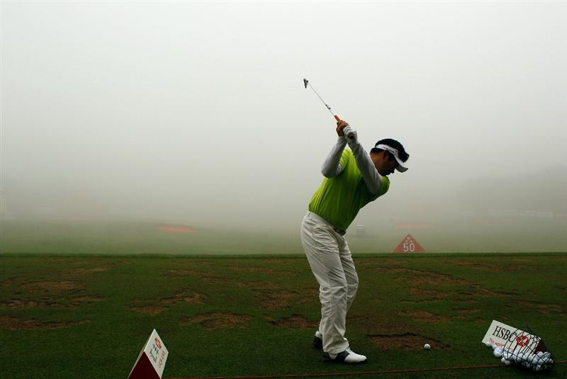 SHANGHAI, CHINA - NOVEMBER 07:  Y.E. Yang of South Korea hits a shot on the practice ground during a fog delay in the final round of the HSBC Champions at the Sheshan Golf Club on November 7, 2010 in Shanghai, China.  (Photo by Scott Halleran/Getty Images)