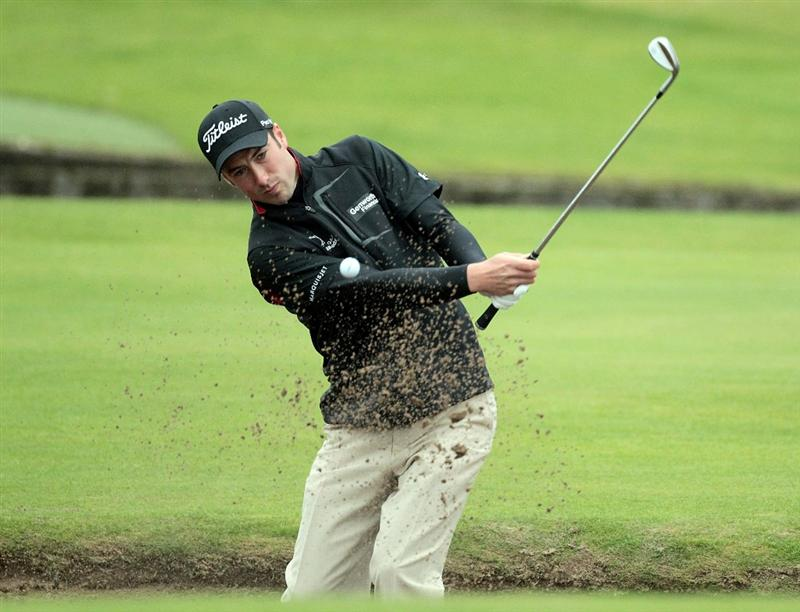 CARNOUSTIE, SCOTLAND - OCTOBER 09:  Ross Fisher of England plays out from the bunker on the 18th geen during the third round of The Alfred Dunhill Links Championship at the Carnoustie Golf Links on October 9, 2010 in Carnoustie, Scotland.  (Photo by David Cannon/Getty Images)