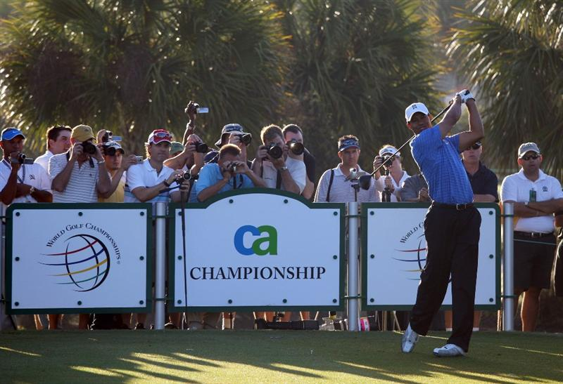DORAL, FL - MARCH 11:  Tiger Woods of the USA drives from the 7th tee during the final day of practice for the World Golf Championships-CA Championship at the Doral Golf Resort & Spa on March 11, 2009 in Miami, Florida  (Photo by David Cannon/Getty Images)