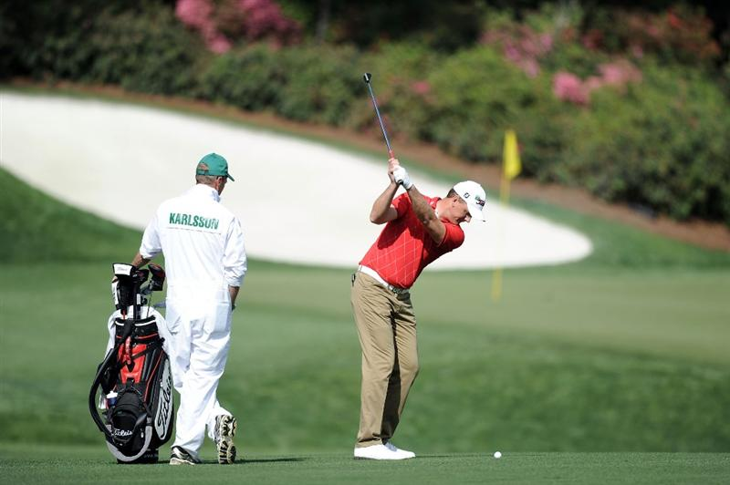 AUGUSTA, GA - APRIL 07:  Robert Karlsson of Sweden hits a shot during a practice round prior to the 2010 Masters Tournament at Augusta National Golf Club on April 7, 2010 in Augusta, Georgia.  (Photo by Harry How/Getty Images)