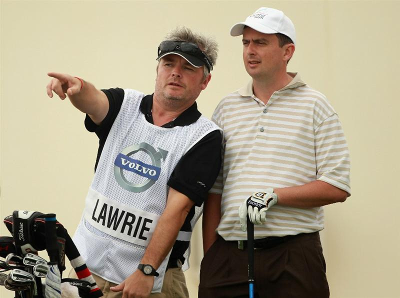 BAHRAIN, BAHRAIN - JANUARY 27:  Peter Lawrie of Ireland waits with his caddie on the 17th hole during the first round of the Volvo Golf Champions at The Royal Golf Club on January 27, 2011 in Bahrain, Bahrain.  (Photo by Andrew Redington/Getty Images)