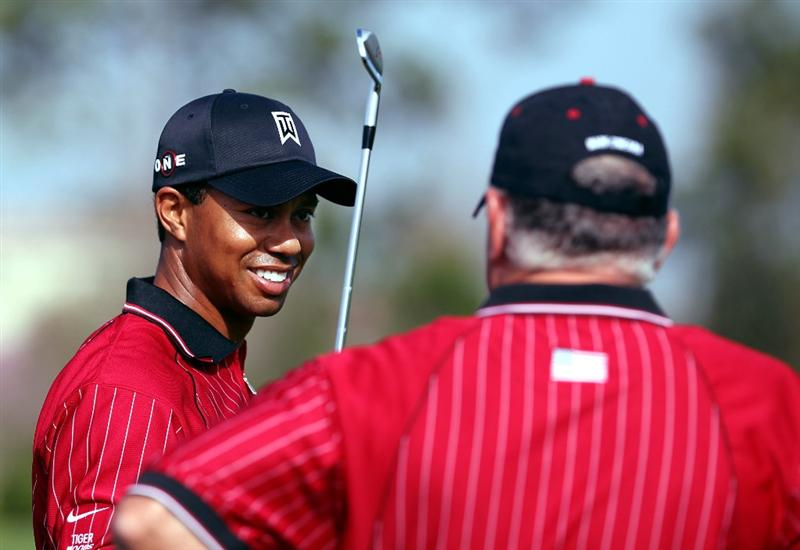 ORLANDO, FL - MARCH 16: Tiger Woods (L) chats with Mark O'Meara on the practices  tee prior to the Tavistock Cup on March 16, 2009 at Lake Nona Country Club in Orlando, Florida.  (Photo by Marc Serota/Getty Images)