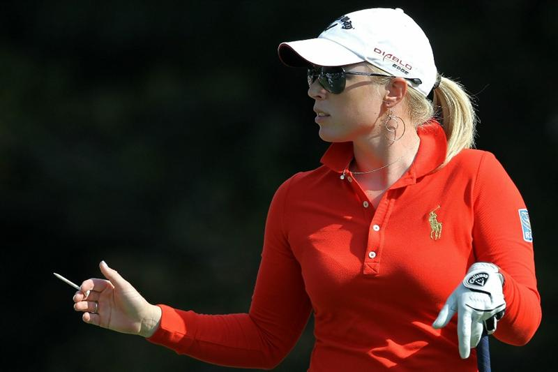 SHIMA, JAPAN - NOVEMBER 06:  Morgan Pressel of the United States reacts after playing a tee shot on the 9th hole during the round two of the Mizuno Classic at Kintetsu Kashikojima Country Club on November 6, 2010 in Shima, Mie, Japan.  (Photo by Kiyoshi Ota/Getty Images)