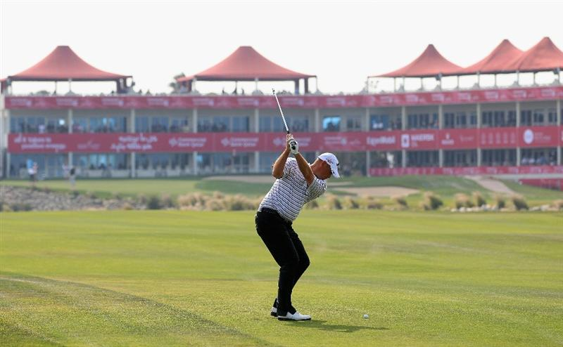 DOHA, QATAR - FEBRUARY 06:  Thomas Bjorn of Denmark plays his second shot on the ninth hole during the final round of the Commercialbank Qatar Masters held at Doha Golf Club on February 6, 2011 in Doha, Qatar.  (Photo by Andrew Redington/Getty Images)