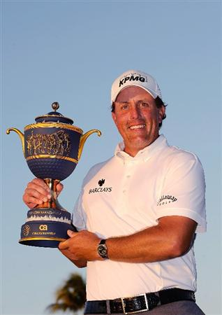 DORAL, FL - MARCH 15:  Phil Mickelson holds the trophy after winning the World Golf Championships-CA Championship at the Doral Golf Resort & Spa on March 15, 2009 in Doral, Florida.  (Photo by Sam Greenwood/Getty Images)