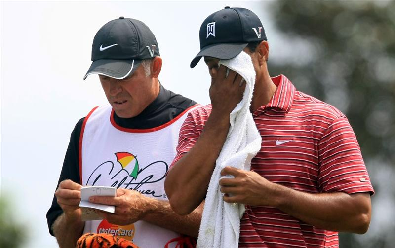 ORLANDO, FL - MARCH 29:  Tiger Woods wipes his face alongside his caddie Steve Williams on the second hole during the final round of the Arnold Palmer Invitational at the Bay Hill Club & Lodge on March 29, 2009 in Orlando, Florida.  (Photo by Scott Halleran/Getty Images)