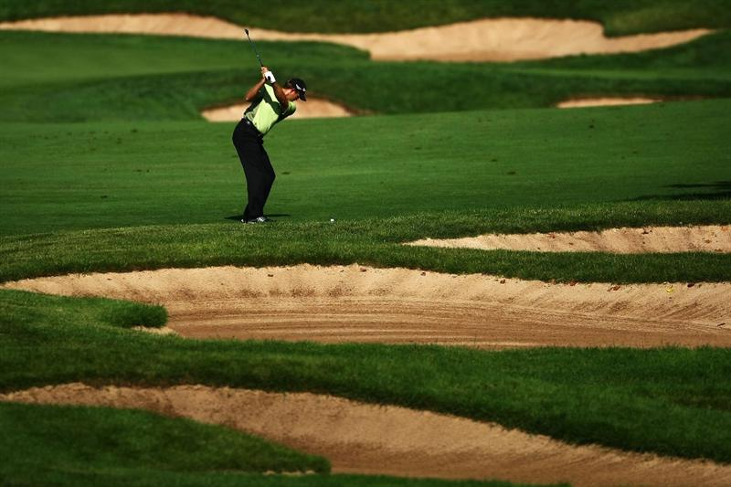 OAKVILLE, ONTARIO - JULY 26: Retief Goosen of South Africa plays his second shot on the 17th hole during round three of the RBC Canadian Open at Glen Abbey Golf Club on July 26, 2009 in Oakville, Ontario, Canada.  (Photo by Chris McGrath/Getty Images)
