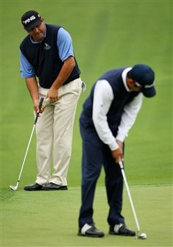 AUGUSTA, GA - APRIL 07:  Andres Romero (R) and Angel Cabrera both of Argentina putt during the first day of practice prior to the start of the 2008 Masters Tournament at Augusta National Golf Club on April 7, 2008 in Augusta, Georgia.  (Photo by Andrew Redington/Getty Images)