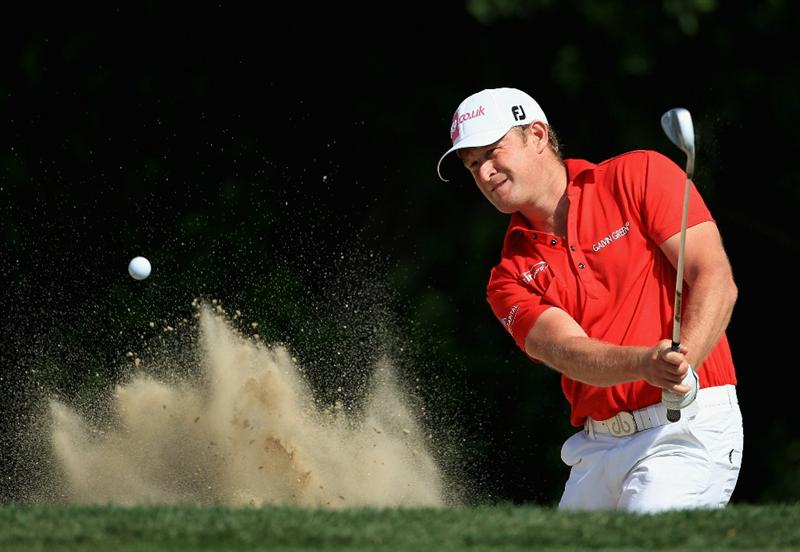 DUBAI, UNITED ARAB EMIRATES - FEBRUARY 10:  Jamie Donaldson of Wales plays a bunker shot on the 14th hole during the first round of the Omega Dubai Desert Classic on the Majlis course at the Emirates Golf Club on February 10, 2011 in Dubai, United Arab Emirates.  (Photo by Andrew Redington/Getty Images)
