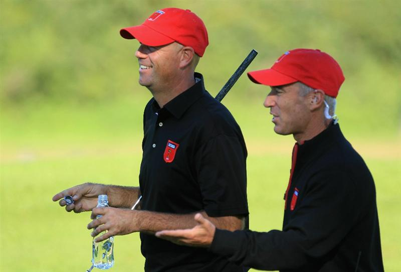 NEWPORT, WALES - OCTOBER 04:  USA Captain Corey Pavin chats with Stewart Cink in the singles matches during the 2010 Ryder Cup at the Celtic Manor Resort on October 4, 2010 in Newport, Wales.  (Photo by David Cannon/Getty Images)