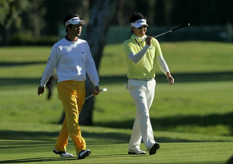 PACIFIC PALISADES, CA - FEBRUARY 17:  Yuta Ikeda (L) and Ryuji Imada of Japan walk together on the third hole during round one of the Northern Trust Open at Riviera Counrty Club on February 17, 2011 in Pacific Palisades, California.  (Photo by Stephen Dunn/Getty Images)