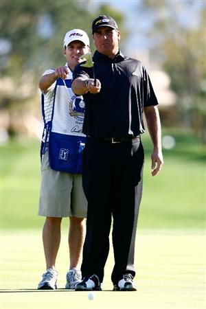 LA QUINTA, CA - JANUARY 25:  Pat Perez and his caddie Mike Hartford line up a putt on the 11th hole during the final round of the Bob Hope Chrysler Classic at the Palmer Course at PGA West on January 25, 2009 in La Quinta, California.  (Photo by Jeff Gross/Getty Images)