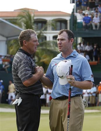 RIO GRANDE, PR - MARCH 13:  Michael Bradley (L) shakes hands with Troy Matteson whom he beat in a one hole playoff to win the Puerto Rico Open presented by seepuertorico.com at Trump International Golf Club on March 13, 2011 in Rio Grande, Puerto Rico.  (Photo by Michael Cohen/Getty Images)