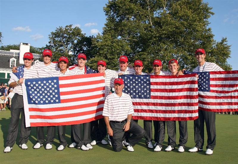 ARDMORE, PA - SEPTEMBER 13:  Buddy Marucci (kneeling) the captain of the USA team with his team on the 18th green after securing victory during the final afternoon singles matches on the East Course at Merion Golf Club on September 13, 2009 in Ardmore, Pennsylvania  (Photo by David Cannon/Getty Images)