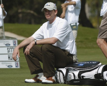 Tom Gillis waits for play on the eighth  hole during  final-round competition March 6, 2005  at the Ford Championship at Doral in Miami.
