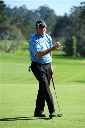 PEBBLE BEACH, CA - FEBRUARY 14: Paul Goydos waves to the gallery after putting on the 13th hole during the final round of the AT&T Pebble Beach National Pro-Am at Pebble Beach Golf Links on February 14, 2010 in Pebble Beach, California.  (Photo by Stuart Franklin/Getty Images)