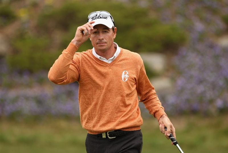 ICHEON, SOUTH KOREA - APRIL 29:  Brett Rumford of Australia acknowledges the crowd on the ninth hole during the second round of the Ballantine's Championship at Blackstone Golf Club on April 29, 2011 in Icheon, South Korea.  (Photo by Andrew Redington/Getty Images)