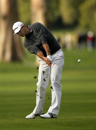 PACIFIC PALISADES, CA - FEBRUARY 04:  Dustin Johnson hits from the fairway on the 17th hole during the first round of the Northern Trust Open at Riveria Country Club on February 4, 2010 in Pacific Palisades, California.  (Photo by Stephen Dunn/Getty Images)