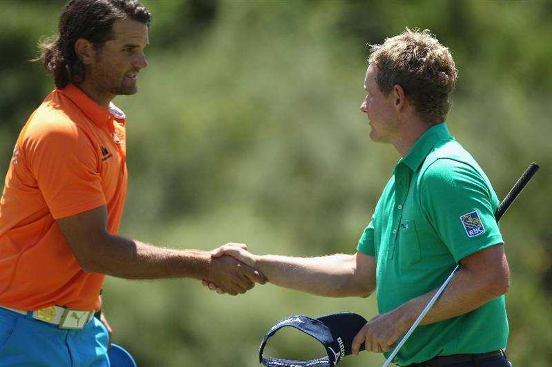 CASARES, SPAIN - MAY 21:  Luke Donald of England (right) shakes hands with Johan Edfors of Sweden after winning their last 16 match at the Volvo World Match Play Championship at Finca Cortesin on May 21, 2011 in Casares, Spain.  (Photo by Andrew Redington/Getty Images)