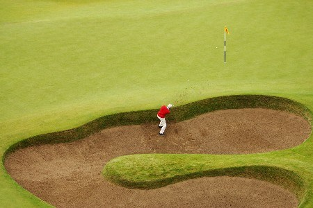 CARNOUSTIE, UNITED KINGDOM - JULY 22:  Markus Brier of Austria plays a bunker shot on the 18th hole during the final round of The 136th Open Championship at the Carnoustie Golf Club on July 22, 2007 in Carnoustie, Scotland.  (Photo by Warren Little/Getty Images)