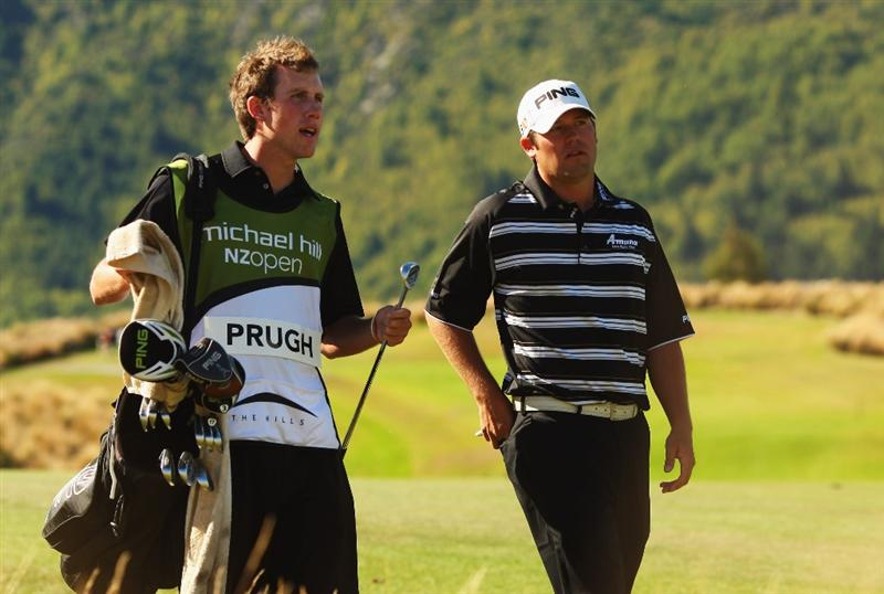 QUEENSTOWN, NEW ZEALAND - MARCH 15:  Alex Prugh of the USA walks up the 14th hole with his caddy during day four of the New Zealand Men's Open Championship at The Hills Golf Club on March 15, 2009 in Queenstown, New Zealand.  (Photo by Phil Walter/Getty Images)