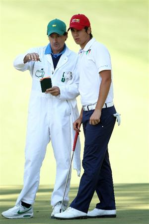 AUGUSTA, GA - APRIL 09:  Amateur Matteo Manassero of Italy looks over the tenth green with his caddie Alberto Binaghi during the second round of the 2010 Masters Tournament at Augusta National Golf Club on April 9, 2010 in Augusta, Georgia.  (Photo by Andrew Redington/Getty Images)