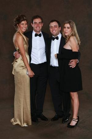 NEWPORT, WALES - SEPTEMBER 29:  Edoardo Molinari (left-center) of the European Ryder Cup team poses with his partner Anna Roscio alongside his brother Francesco Molinari and his wife Valentina prior to the 2010 Ryder Cup Dinner at the Celtic Manor Resort on September 29, 2010 in Newport, Wales.  (Photo by David Cannon/Getty Images)